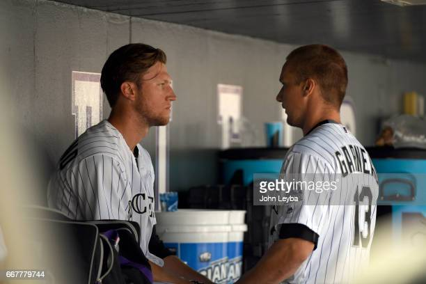 Colorado Rockies catcher Dustin Garneau has a little pep talk with Colorado Rockies starting pitcher Kyle Freeland after the first inning against the...