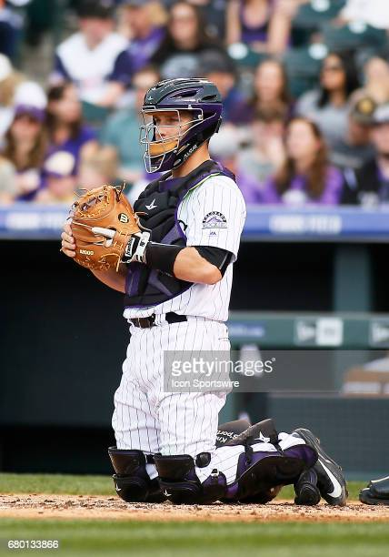 Colorado Rockies Catcher Dustin Garneau waits for a pitch during a regular season MLB game between the Colorado Rockies and the visiting Arizona...