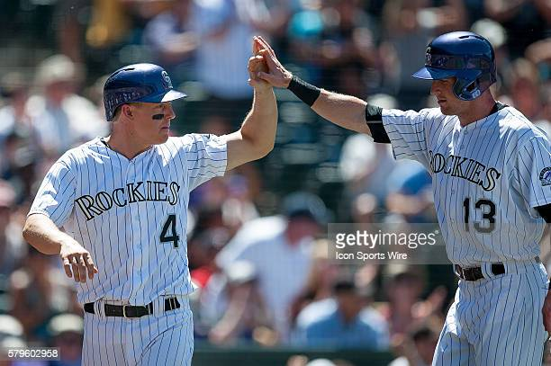 Colorado Rockies catcher Nick Hundley and Colorado Rockies center fielder Drew Stubbs celebrate a pair of runs scored during a regular season Major...