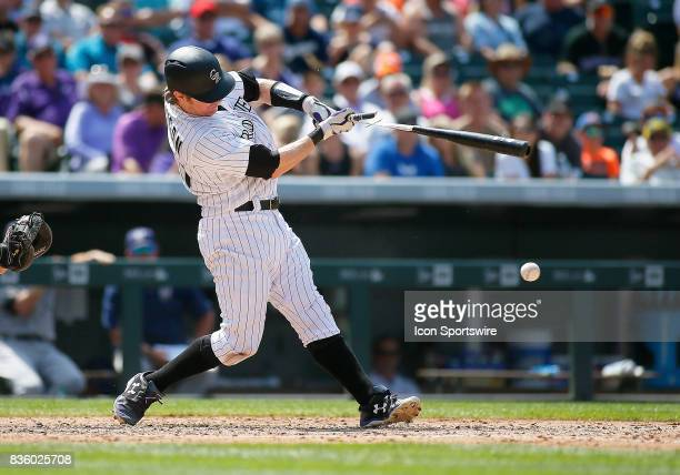 Colorado Rockies Catcher Ryan Hanigan breaks hit bat on a pitch during a regular season MLB game between the Colorado Rockies and the visiting...