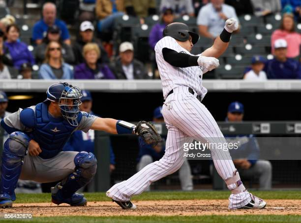 Colorado Rockies catcher Tony Wolters loses his bat into the crowd in the 7th inning against the Los Angeles Dodgers at Coors Field October 01 2017