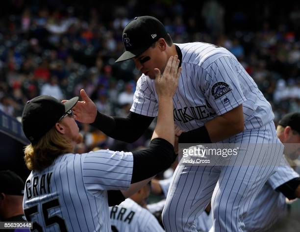 Colorado Rockies catcher Tony Wolters right and Colorado Rockies starting pitcher Jon Gray in the dugout before the game against the Los Angeles...