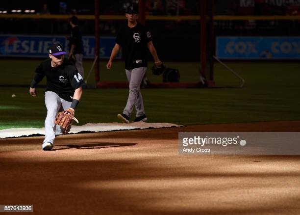 Colorado Rockies catcher Tony Wolters takes infield practice before the National League Wild Card playoff game at Chase Field October 04 2017