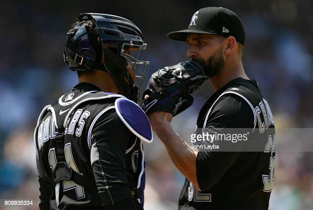 Colorado Rockies catcher Tony Wolters visits Colorado Rockies starting pitcher Tyler Chatwood on the mound in the fourth inning against the...