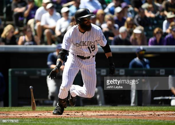 Colorado Rockies center fielder Charlie Blackmon gets a base hit during the first inning off of San Diego Padres starting pitcher Zach Lee on April...
