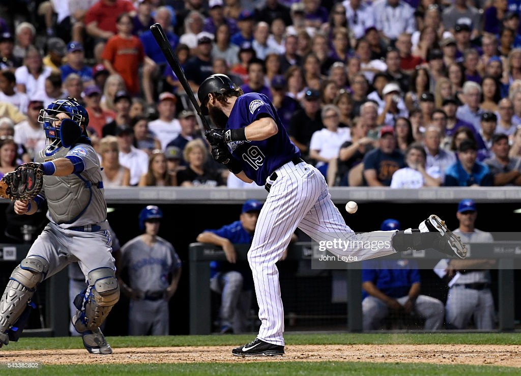 Colorado Rockies center fielder <a gi-track='captionPersonalityLinkClicked' href=/galleries/search?phrase=Charlie+Blackmon&family=editorial&specificpeople=7519880 ng-click='$event.stopPropagation()'>Charlie Blackmon</a> (19) gets hit by a pitch thrown by Toronto Blue Jays relief pitcher Drew Storen (45) during the seventh inning June 27, 2016 at Coors Field.
