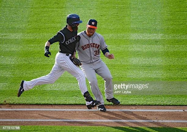 Colorado Rockies center fielder Charlie Blackmon gets tagged out by Houston Astros starting pitcher Brett Oberholtzer after a slow hit down the first...