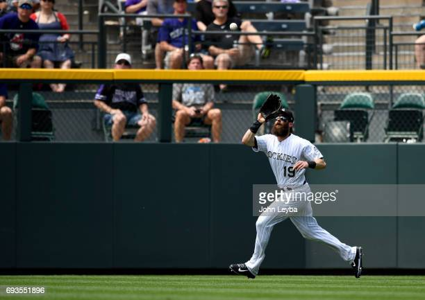 Colorado Rockies center fielder Charlie Blackmon waits for a fly ball hit by Cleveland Indians left fielder Michael Brantley in the fourth inning on...