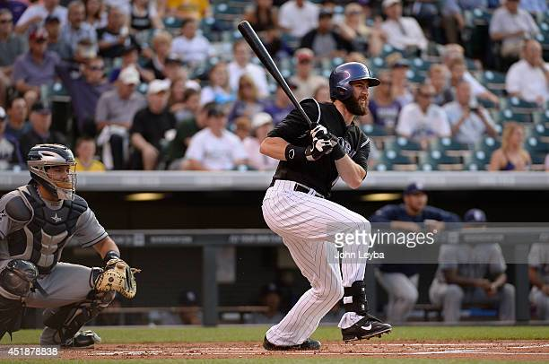 Colorado Rockies center fielder Charlie Blackmon watches his hit sail in to right field for a double during the first inning against the San Diego...