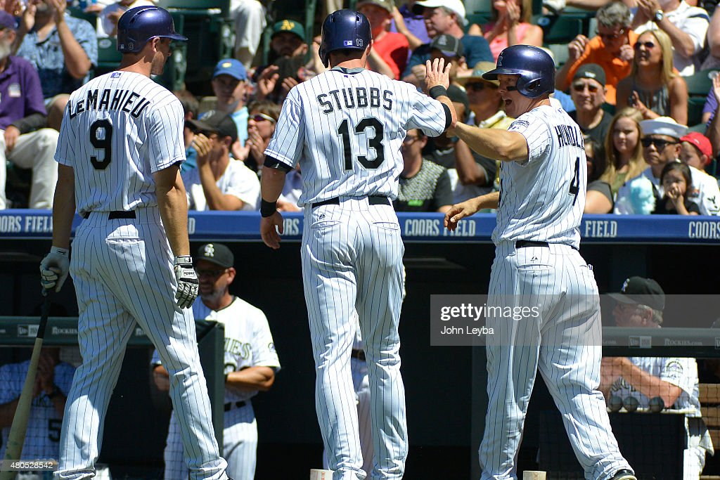 Colorado Rockies center fielder <a gi-track='captionPersonalityLinkClicked' href=/galleries/search?phrase=Drew+Stubbs+-+Baseball+Player&family=editorial&specificpeople=4498334 ng-click='$event.stopPropagation()'>Drew Stubbs</a> (13) and Colorado Rockies catcher <a gi-track='captionPersonalityLinkClicked' href=/galleries/search?phrase=Nick+Hundley&family=editorial&specificpeople=4175399 ng-click='$event.stopPropagation()'>Nick Hundley</a> (4) high five as they score off a Colorado Rockies center fielder Charlie Blackmon (19) single against the Atlanta Braves in the second inning July 12, 2015 at Coors Field.