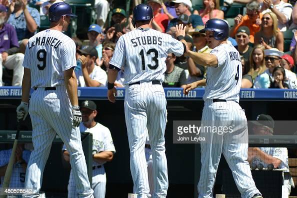 Colorado Rockies center fielder Drew Stubbs and Colorado Rockies catcher Nick Hundley high five as they score off a Colorado Rockies center fielder...