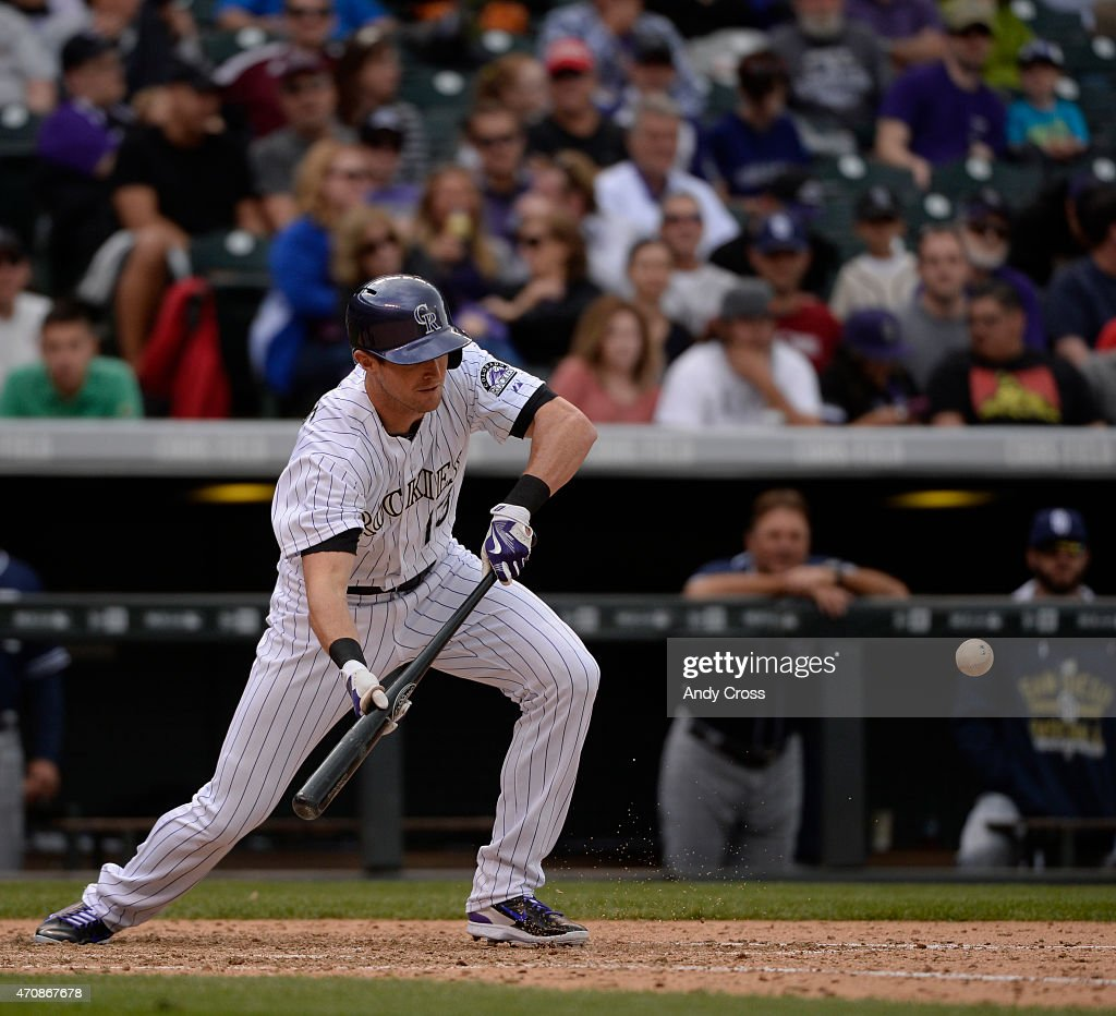 Colorado Rockies center fielder <a gi-track='captionPersonalityLinkClicked' href=/galleries/search?phrase=Drew+Stubbs+-+Baseball+Player&family=editorial&specificpeople=4498334 ng-click='$event.stopPropagation()'>Drew Stubbs</a> #13 bunts against the San Diego Padres in the 8th inning at Coors Field April 23, 2015. Stubbs was out at first , but advanced Rafael Ynoa #43 (not pictured) to third.