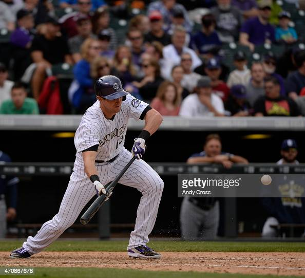 Colorado Rockies center fielder Drew Stubbs bunts against the San Diego Padres in the 8th inning at Coors Field April 23 2015 Stubbs was out at first...