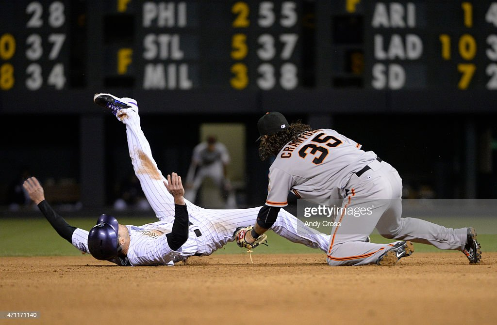 Colorado Rockies center fielder <a gi-track='captionPersonalityLinkClicked' href=/galleries/search?phrase=Drew+Stubbs+-+Baseball+Player&family=editorial&specificpeople=4498334 ng-click='$event.stopPropagation()'>Drew Stubbs</a> #13 gets tagged out at second on a steal by San Francisco Giants shortstop <a gi-track='captionPersonalityLinkClicked' href=/galleries/search?phrase=Brandon+Crawford&family=editorial&specificpeople=5580312 ng-click='$event.stopPropagation()'>Brandon Crawford</a> #35 9th inning at Coors Field April 25, 2015.