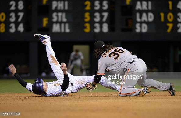 Colorado Rockies center fielder Drew Stubbs gets tagged out at second on a steal by San Francisco Giants shortstop Brandon Crawford 9th inning at...
