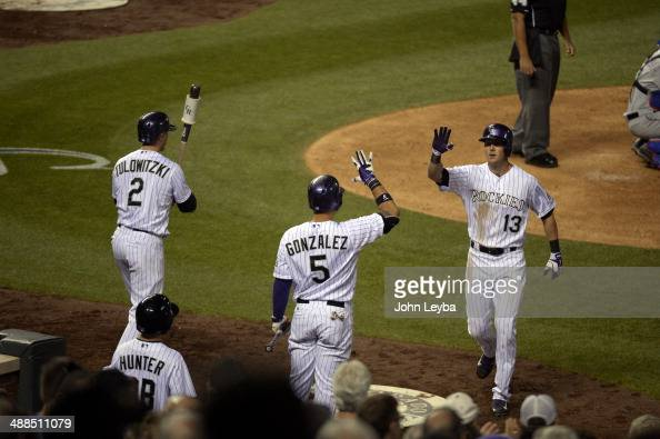 Colorado Rockies center fielder Drew Stubbs high fives Colorado Rockies left fielder Carlos Gonzalez after his home run in the seventh inning against...