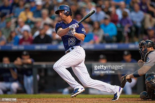 Colorado Rockies center fielder Drew Stubbs hits an RBI single during a regular season Major League Baseball game between the Seattle Mariners and...