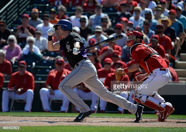 Colorado Rockies center fielder Drew Stubbs singles on a ground ball to shortstop during the first inning against the Los Angeles Angels March 6 2015...