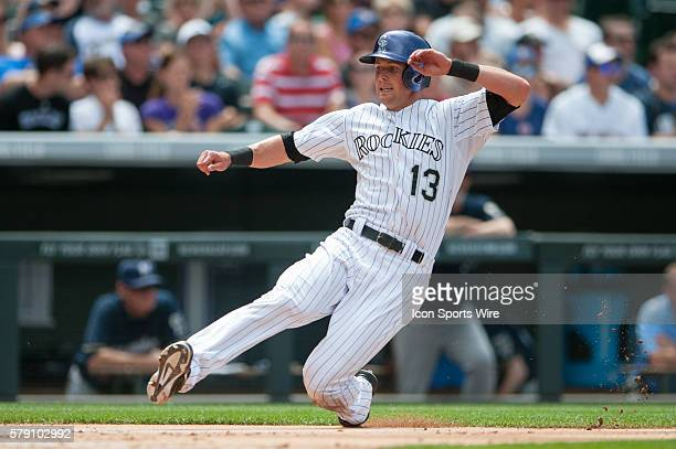 Colorado Rockies center fielder Drew Stubbs slides safely into home plate during a regular season Major League Baseball game between the Milwaukee...