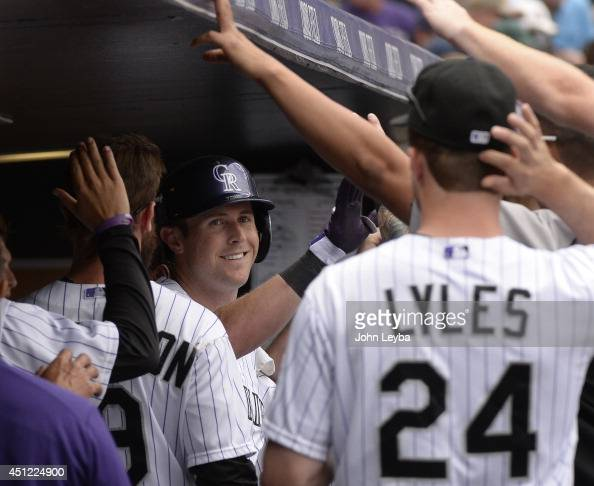 Colorado Rockies center fielder Drew Stubbs smiles int he dugout after hitting a home run in the fourth inning off of St Louis Cardinals starting...