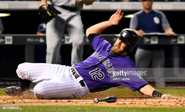 Colorado Rockies first baseman Mark Reynolds slides at home plate for a score on a Tyler Chatwood single during the second inning against the San...