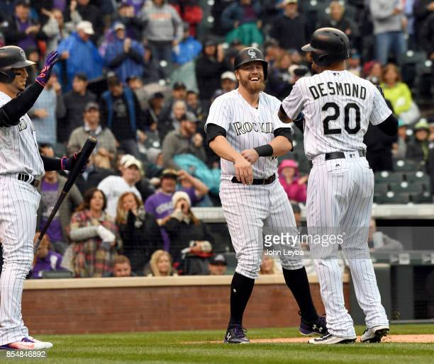 Colorado Rockies first baseman Mark Reynolds smiles in celebration with Colorado Rockies left fielder Ian Desmond after Desmond hit his 7th homer to...