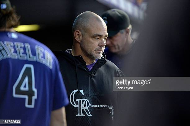 Colorado Rockies hitting coach Dante Bichette walks around in the dugout Boston Red Sox September 24 2013 at Coors Field Bichette announced he will...