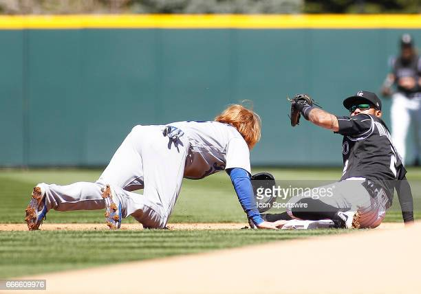 Colorado Rockies Infielder Alexi Amarista looks for the call after applying a tag to Los Angeles Dodgers Infielder Justin Turner on a pickoff attempt...