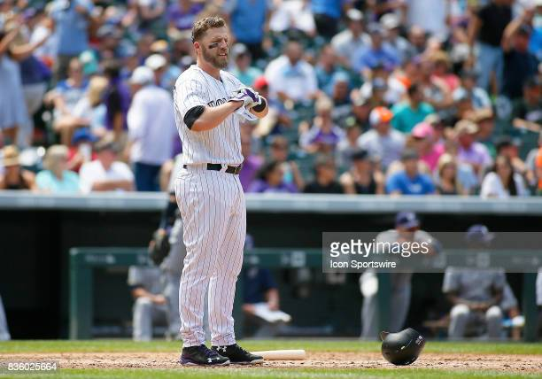 Colorado Rockies Infielder Mark Reynolds stands at home plate following an inning ending strike out during a regular season MLB game between the...