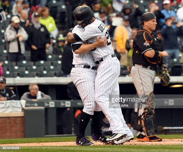 Colorado Rockies left fielder Ian Desmond gets a hug from Colorado Rockies first baseman Mark Reynolds after hitting his 7th homer to right center in...