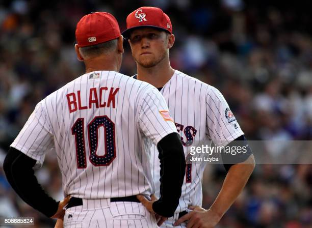 Colorado Rockies manager Bud Black has a little talk on the mound with Colorado Rockies starting pitcher Kyle Freeland during the third inning...