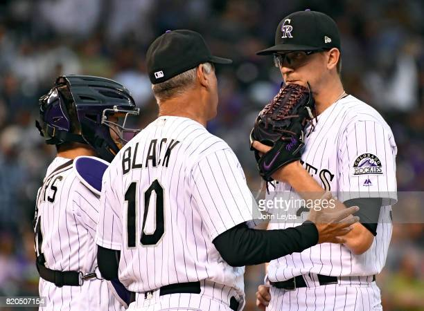 Colorado Rockies manager Bud Black pays a visit to the bond to chat with Colorado Rockies starting pitcher Jeff Hoffman during the first inning...