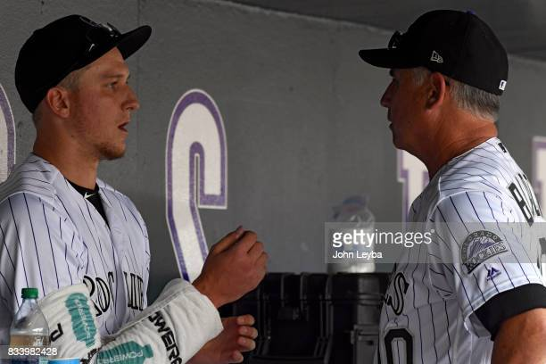 Colorado Rockies manager Bud Black talks with Colorado Rockies starting pitcher Jeff Hoffman in the dugout between innings against the Atlanta Braves...