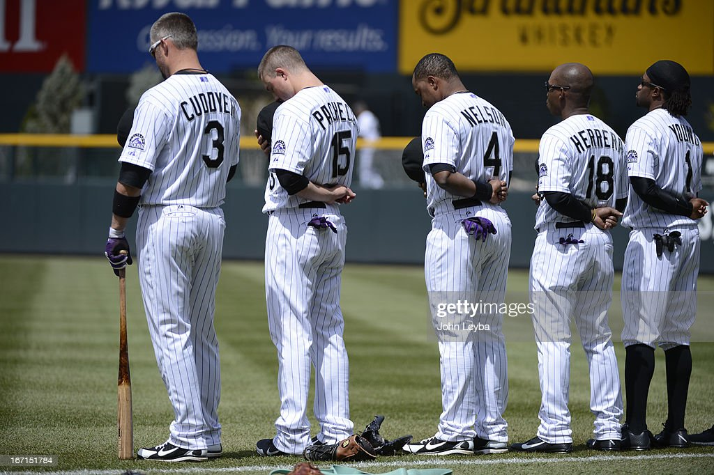 Colorado Rockies Michael Cuddyer (3) Jordan Pacheco (15) Chris Nelson (4) Jonathan Herrera (18) and Eric Young Jr. (1) stand for the national anthem prior to their game against the Arizona DiamondBacks April 21, 2013 at Coors Field.