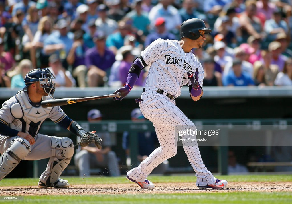 Colorado Rockies Outfielder, Carlos Gonzalez (5) connects for a double during a regular season MLB game between the Colorado Rockies and the visiting Milwaukee Brewers on August 20, 2017 at Coors Field in Denver, CO.