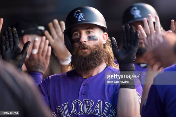 Colorado Rockies outfielder Charlie Blackmon celebrates after scoring a run during the Colorado Rockies game vs the Milwaukee Brewers on August 18...