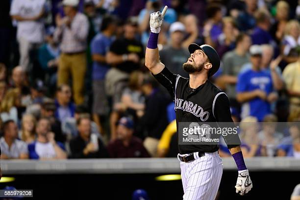 Colorado Rockies outfielder David Dahl celebrates after hitting a tworun home run in the fourth inning during the game at Coors Field against the Los...
