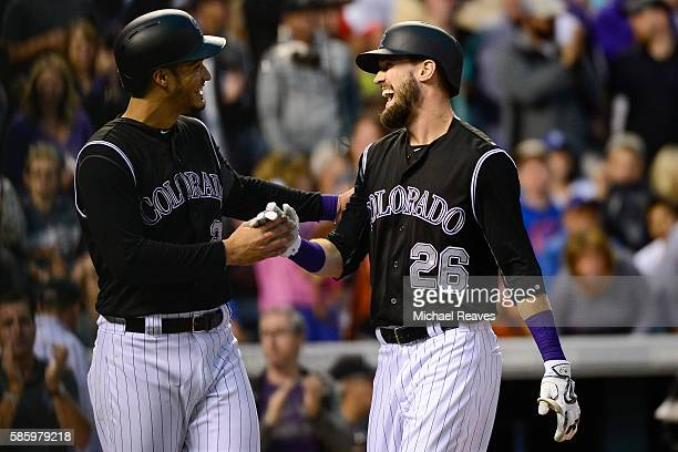 Colorado Rockies outfielder David Dahl celebrates with third basemen Nolan Arenado after hitting a tworun home run in the fourth inning during the...