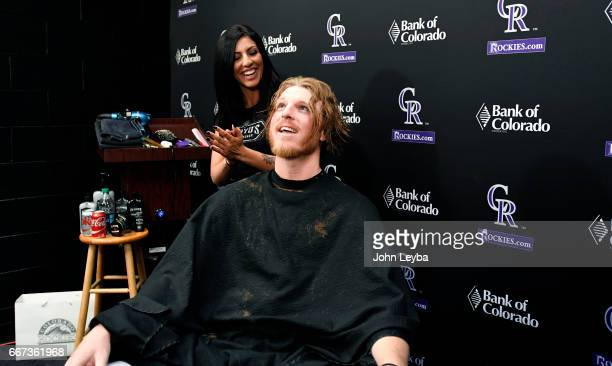 Colorado Rockies pitcher John Gray feels a little light after he shakes out all the loose hair after getting his haircut on April 11 2017 in Denver...