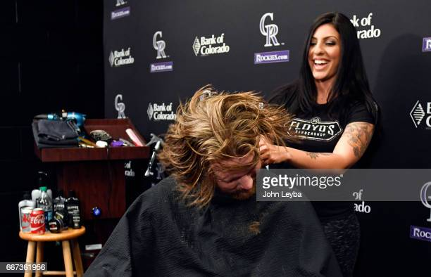 Colorado Rockies pitcher John Gray shakes out all the loose hair after getting his haircut on April 11 2017 in Denver Colorado at Coors Field Gray...