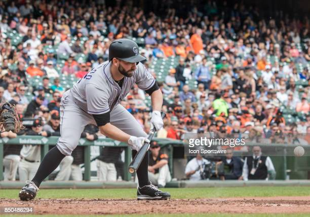 Colorado Rockies Pitcher Tyler Chatwood gets set for a bunt during the regular season game between the San Francisco Giants verses the Colorado...