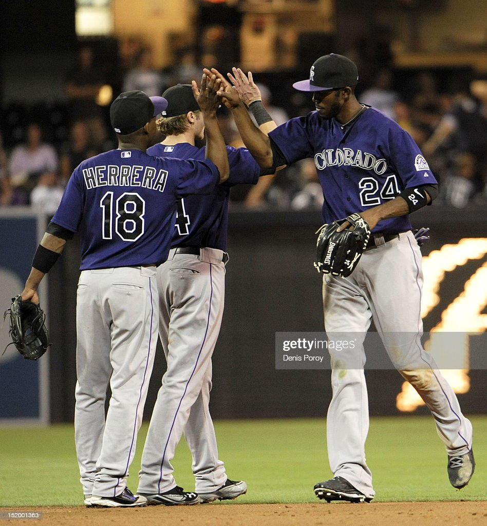 Colorado Rockies players high-five after beating the San Diego Padres 7-4 in a baseball game at Petco Park on September 14, 2012 in San Diego, California.