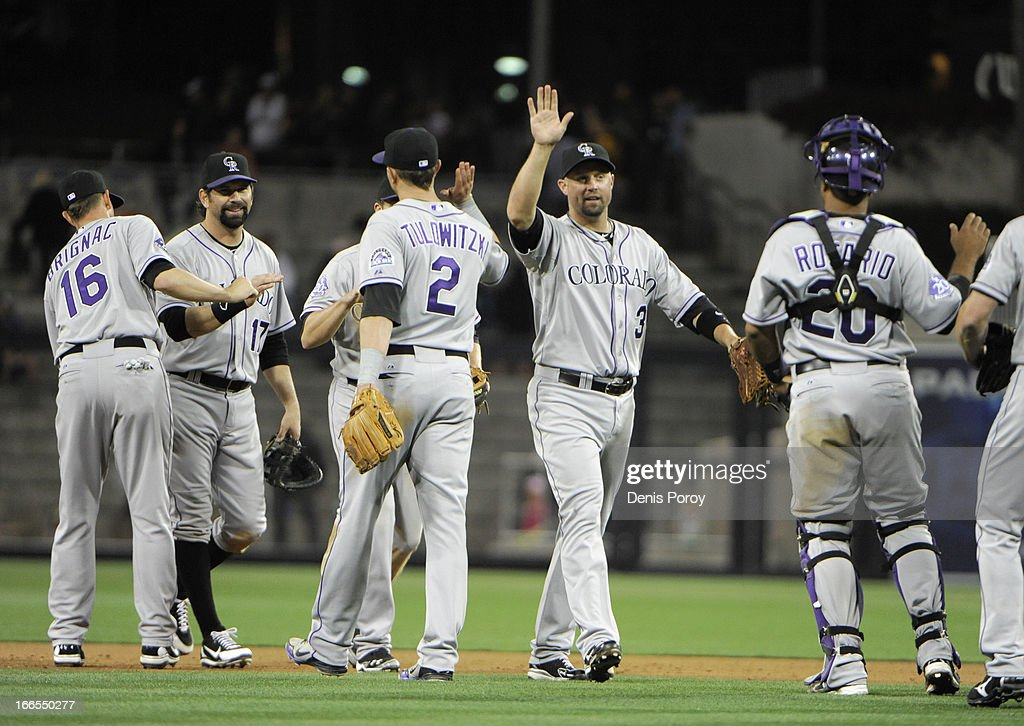 Colorado Rockies players high-five after beating the San Diego Padres 9-5 in a baseball game at Petco Park on April 13, 2013 in San Diego, California.