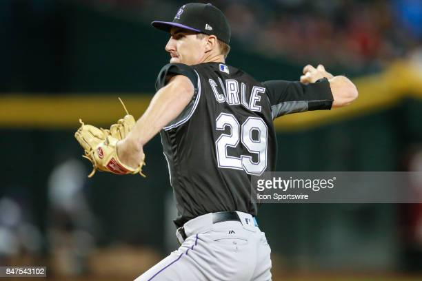 Colorado Rockies relief pitcher Shane Carle throws a pitch during the MLB baseball game between the Colorado Rockies and the Arizona Diamondbacks on...