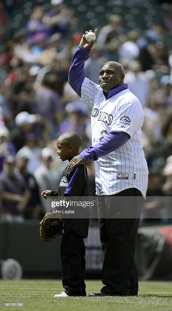 Colorado Rockies retired player Eric Young stands with his son Dallas Young 6-years-old as he acknowledges the crowd during Erick Young bobble head day. Dallas Young threw out the first pitch to his older brother Eric Young Jr. prior to their game against the Arizona DiamondBacks April 21, 2013 at Coors Field.