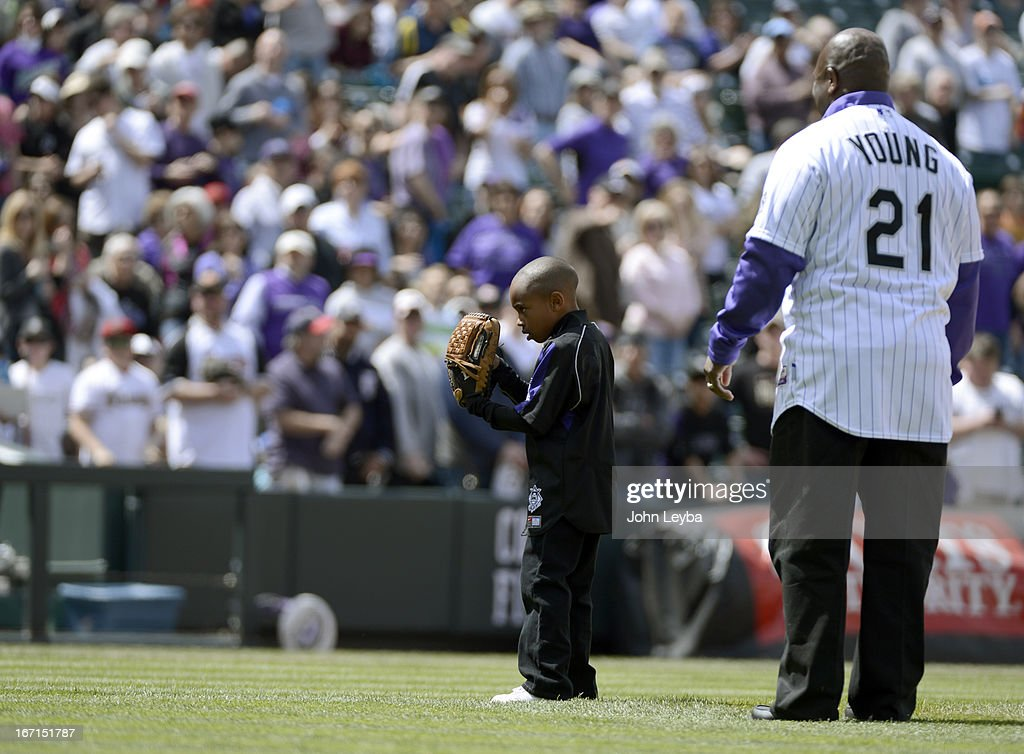 Colorado Rockies retired player Eric Young stands with his son Dallas Young 6-years-old as he prepares to throw out the first pitch to his older brother Eric Young Jr. prior to their game against the Arizona DiamondBacks April 21, 2013 at Coors Field.