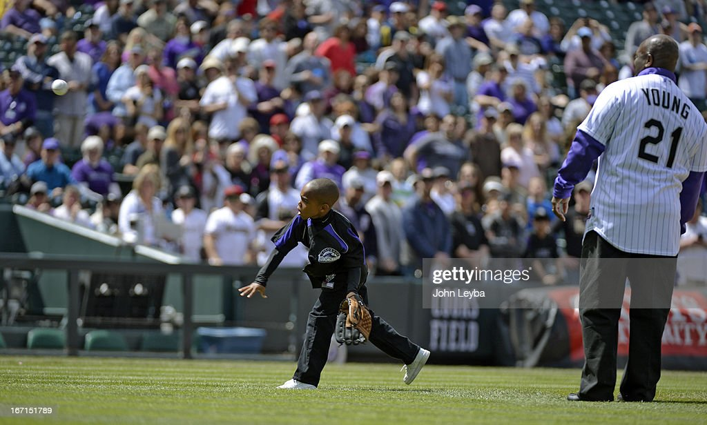 Colorado Rockies retired player Eric Young stands with his son Dallas Young 6-years-old as he throws out the first pitch to his older brother Eric Young Jr. prior to their game against the Arizona DiamondBacks April 21, 2013 at Coors Field.