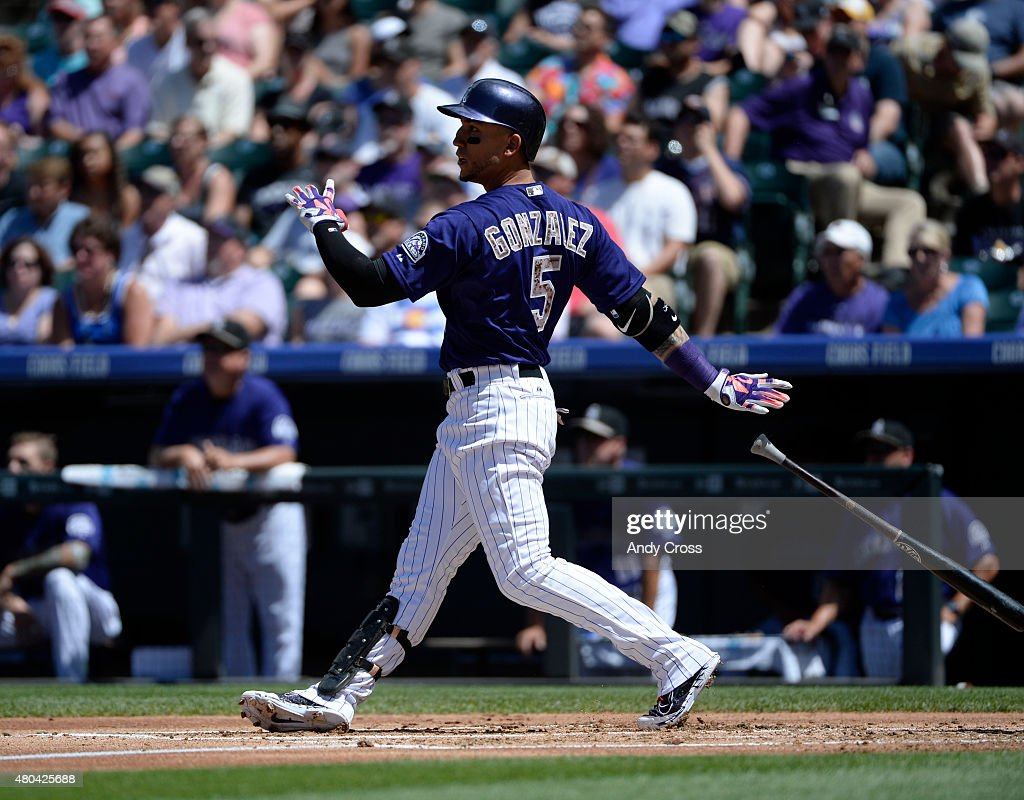 Colorado Rockies right fielder <a gi-track='captionPersonalityLinkClicked' href=/galleries/search?phrase=Carlos+Gonzalez+-+Amerikansk+basebollspelare&family=editorial&specificpeople=7204259 ng-click='$event.stopPropagation()'>Carlos Gonzalez</a> #5 hits a two-run home run against the Atlanta Braves in the first inning at Coors Field July 11, 2015.