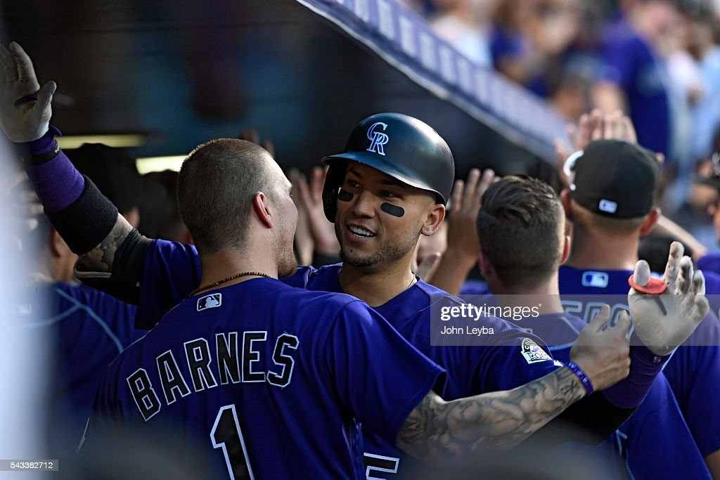 Colorado Rockies right fielder <a gi-track='captionPersonalityLinkClicked' href=/galleries/search?phrase=Carlos+Gonzalez+-+US+Baseball+Player&family=editorial&specificpeople=7204259 ng-click='$event.stopPropagation()'>Carlos Gonzalez</a> (5) is congratulated by Colorado Rockies center fielder <a gi-track='captionPersonalityLinkClicked' href=/galleries/search?phrase=Brandon+Barnes+-+Baseball+Player&family=editorial&specificpeople=10139949 ng-click='$event.stopPropagation()'>Brandon Barnes</a> (1) after his two run home run in the sixth inning against the Toronto Blue Jays June 27, 2016 at Coors Field.