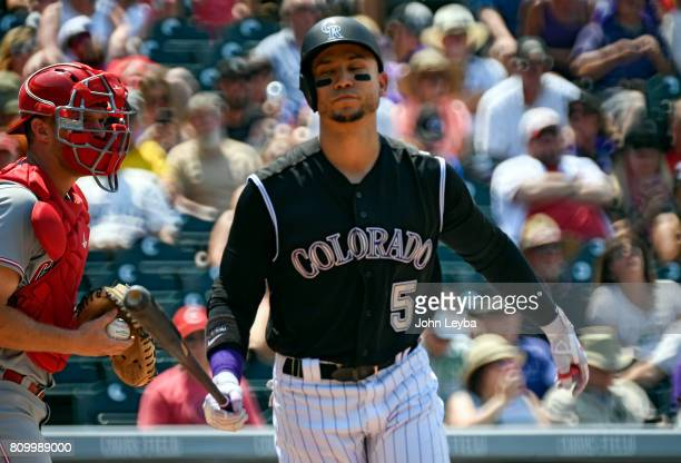 Colorado Rockies right fielder Carlos Gonzalez reacts after striking out during their game agains the Cincinnati Reds on July 6 2017 in Denver...